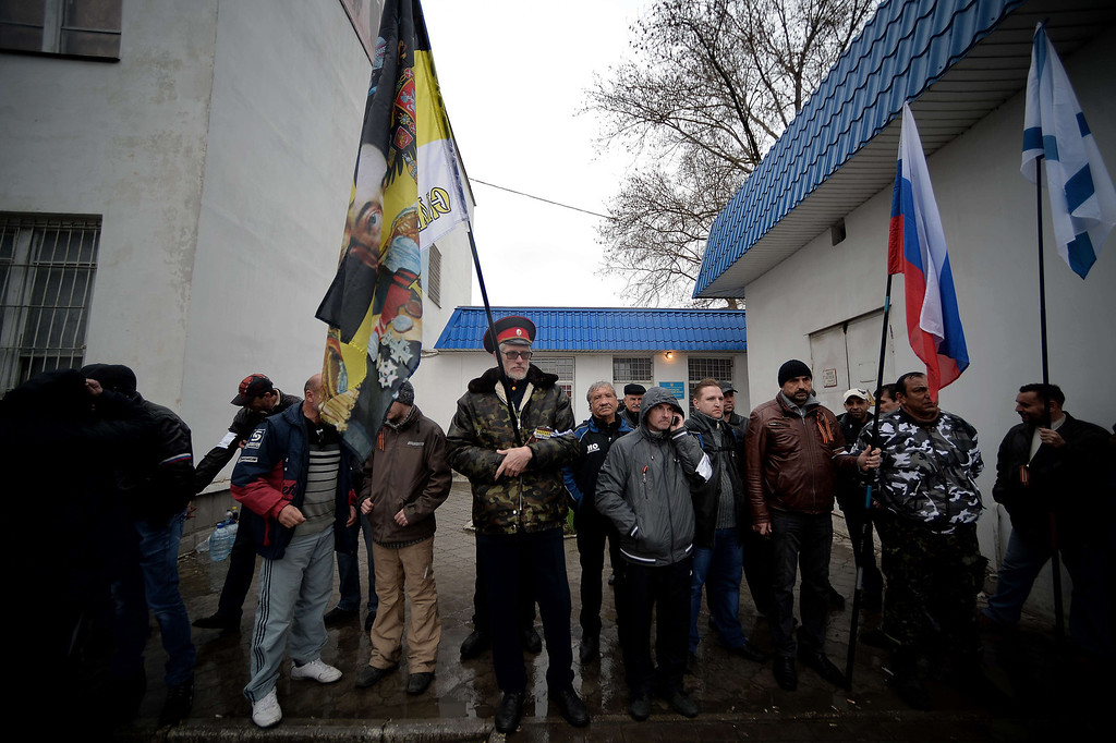 . Pro Russian supporters stand in line ouside the headquarters of the Ukrainian Navy in Sevastopol on March 4, 2014. The Russian Black Sea Fleet commander Aleksandr Vitko has issued an ultimatum to the Ukrainian military personnel in Crimea, the Interfax-Ukraine news agency reported. Ukraine accused Russia on Monday of pouring more troops into Crimea as world leaders grappled with Europe\'s worst standoff since the Cold War and the Moscow market plunged on fears of an all-out conflic  AFP PHOTO/ Filippo MONTEFORTE/AFP/Getty Images