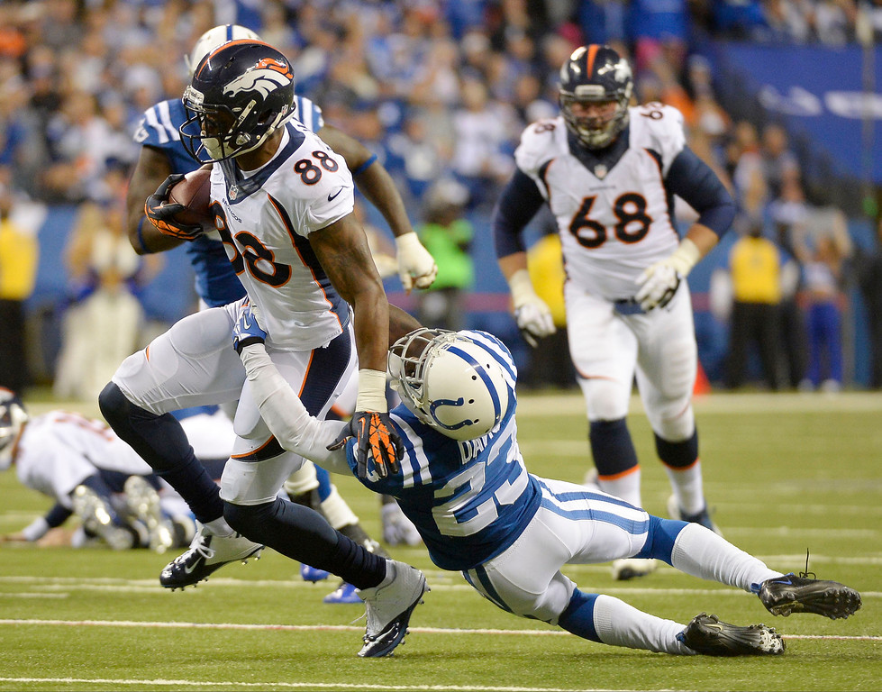 . Denver Broncos wide receiver Demaryius Thomas (88) gets caught by Indianapolis Colts cornerback Vontae Davis (23) during the fourth quarter October 20, 2013 at Lucas Oil Field. Photo by John Leyba/The Denver Post)
