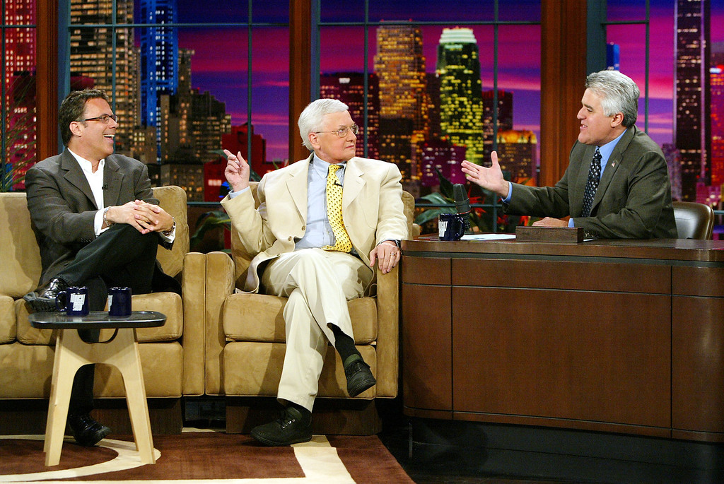 ". Film critics Richard Roeper (left) and Roger Ebert appear on ""The Tonight Show with Jay Leno\"" on July 29, 2004 at the NBC Studios, in Burbank, California. (Photo by Kevin Winter/Getty Images)"