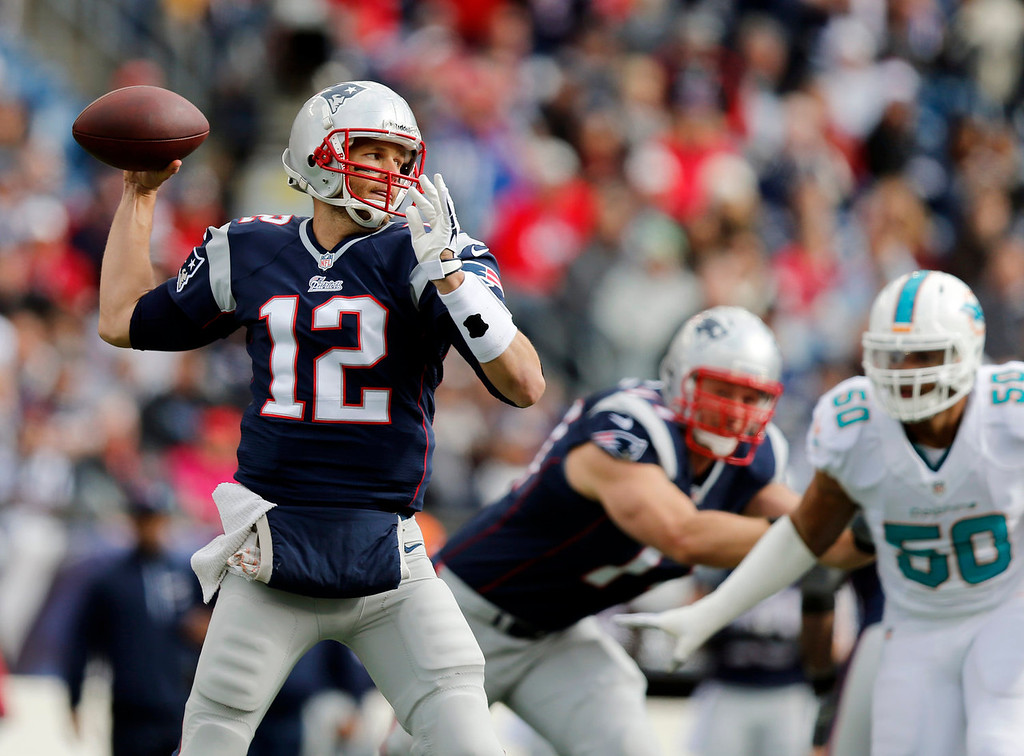 . New England Patriots quarterback Tom Brady (12) passes against the Miami Dolphins in the first half of an NFL football game on Sunday, Oct. 27, 2013, in Foxborough, Mass. (AP Photo/Michael Dwyer)
