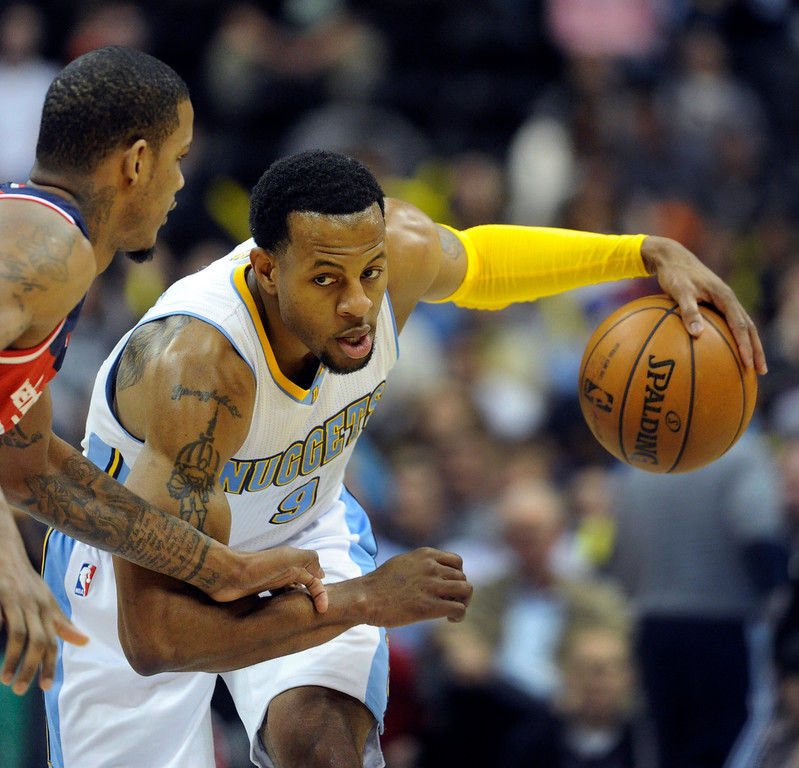 . DENVER, CO - JANUARY 18: Denver guard Andre Iguodala (9) kept the ball from Washington defender Trevor Ariza (1) in the first half. The Denver Nuggets hosted the Washington Wizard at the Pepsi Center Friday night, January 18, 2013. Karl Gehring/The Denver Post