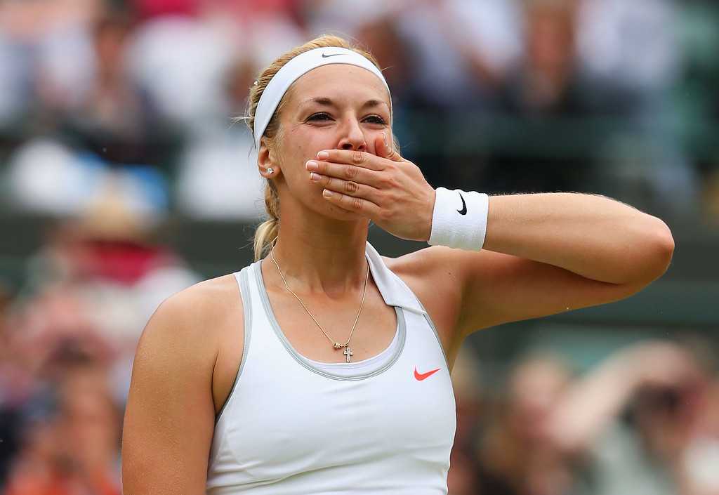 . LONDON, ENGLAND - JULY 02:  Sabine Lisicki of Germany celebrates victory during the Ladies\' Singles quarter-final match against Kaia Kanepi of Estonia on day eight of the Wimbledon Lawn Tennis Championships at the All England Lawn Tennis and Croquet Club at Wimbledon on July 2, 2013 in London, England.  (Photo by Julian Finney/Getty Images)