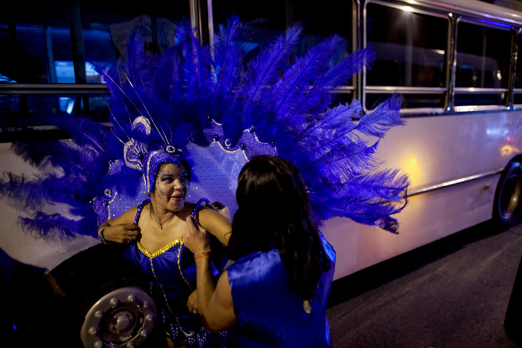 ". Members of the murga ""Los amantes de La Boca\"" prepare before participating in carnival celebrations in Buenos Aires, Argentina, Saturday, Feb. 2, 2013. (AP Photo/Natacha Pisarenko)"