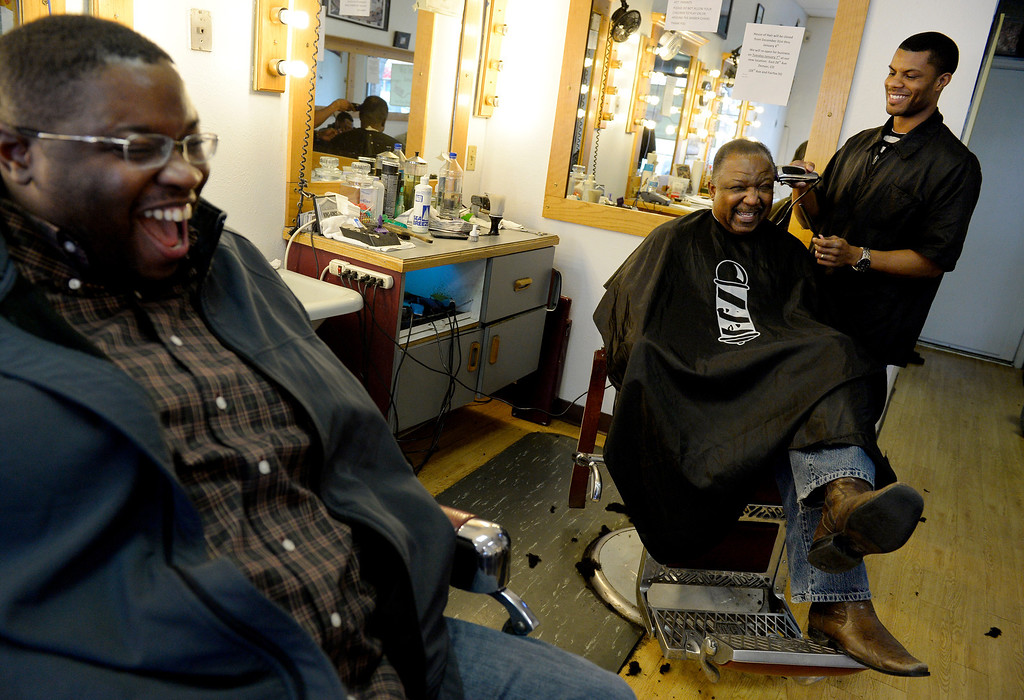 ". DENVER, CO. - DECEMBER 21: (l-r) Noah Osborne and Chaz Rapier share a laugh with owner Marcus Pope at House of Hair in Denver, CO December 21, 2013. The shop will be relocating to 523 East 28th Ave and reopening on January 07, 2014. Owner Marcus Pope said, ""we didn\'t have a choice. The restaurant next door is expanding so they didn\'t renew our lease... I wasn\'t happy with the way it happened but I\'m looking forward to a new opportunity.\""  (Photo By Craig F. Walker / The Denver Post)"