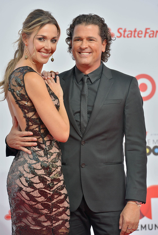 . MIAMI, FL - APRIL 25:  Carlos Vives (R) arrives at Billboard Latin Music Awards 2013 at Bank United Center on April 25, 2013 in Miami, Florida.  (Photo by Gustavo Caballero/Getty Images)