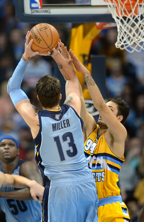 . DENVER, CO. - JANUARY 03:  Memphis forward Mike Miller (13) put up a jump shot defended by Denver guard Evan Fournier (94) in the second half. The Denver Nuggets broke an eight-game losing streak with a 111-108 win over the Memphis Grizzlies at the Pepsi Center Friday night, January 3, 2014. Photo By Karl Gehring/The Denver Post