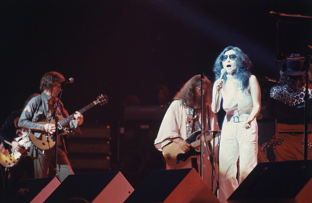 ". Former Beatle John Lennon\'s wife Yoko Ono, right, performs during ""One To One\"", a charity concert to benefit mentally challenged children, at New York\'s Madison Square Garden, Aug. 30, 1972. Lennon plays guitar at far left. (AP Photo/Dave Pickoff)"