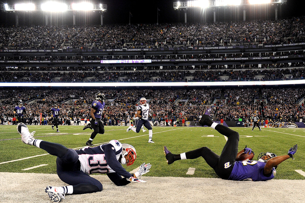 . Wide receiver Torrey Smith #82 of the Baltimore Ravens is tackled by strong safety Duron Harmon #30 of the New England Patriots in the third quarter at M&T Bank Stadium on December 22, 2013 in Baltimore, Maryland. The New England Patriots won, 41-7. (Photo by Patrick Smith/Getty Images)