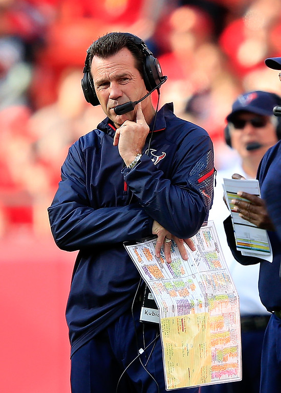 . Head coach Gary Kubiak of the Houston Texans watches from the sidelines during the game against the Kansas City Chiefs at Arrowhead Stadium on October 20, 2013 in Kansas City, Missouri.  (Photo by Jamie Squire/Getty Images)