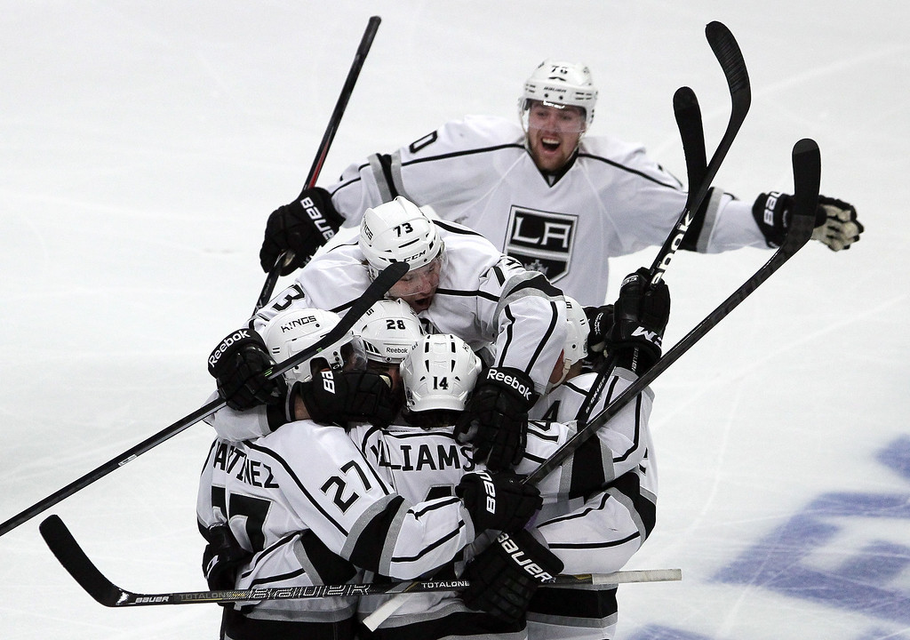 . The Los Angeles Kings celebrate defeating the Chicago Blackhawks 5 to 4 in overtime in Game Seven to win the Western Conference Final in the 2014 Stanley Cup Playoffs at United Center on June 1, 2014 in Chicago, Illinois.  (Photo by Tasos Katopodis/Getty Images)