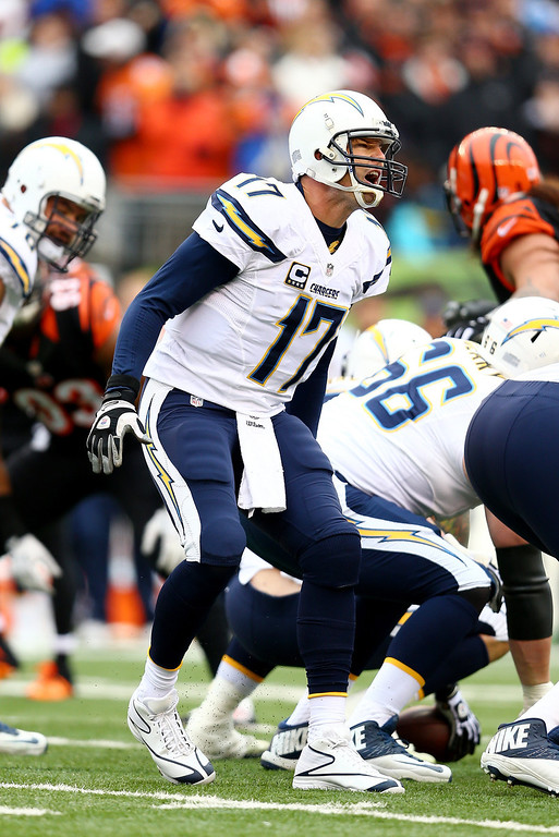 . Quarterback Philip Rivers #17 of the San Diego Chargers calls a play against the Cincinnati Bengals during a Wild Card Playoff game at Paul Brown Stadium on January 5, 2014 in Cincinnati, Ohio.  (Photo by Andy Lyons/Getty Images)
