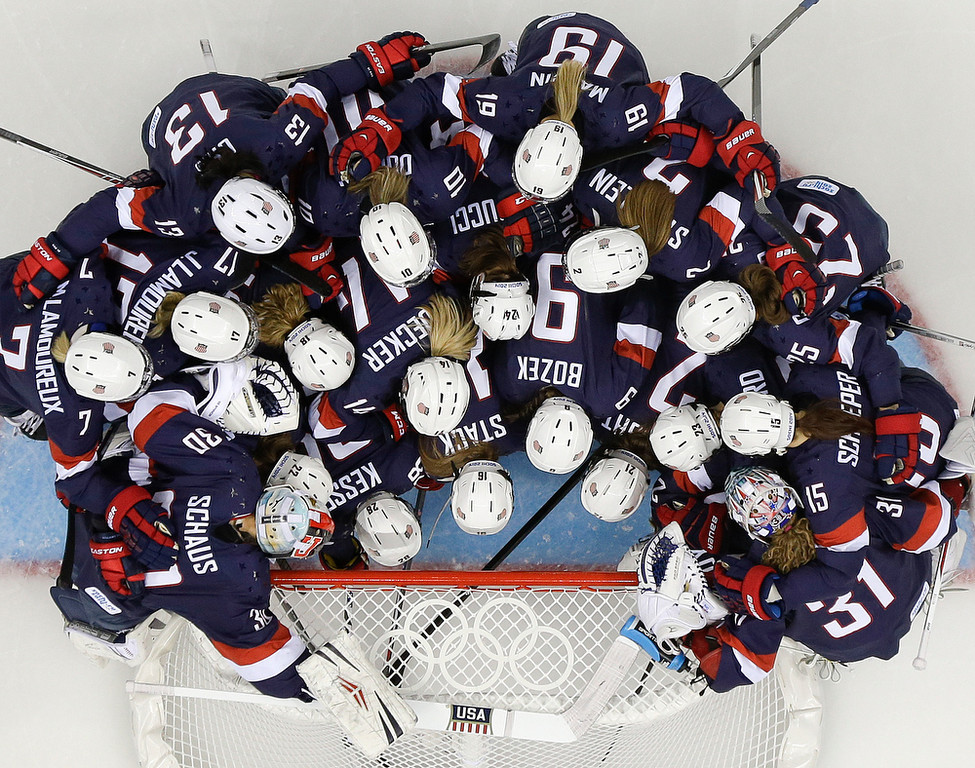 . Team USA gathers around the net before playing Sweden in the 2014 Winter Olympics women\'s semifinal ice hockey game at Shayba Arena, Monday, Feb. 17, 2014, in Sochi, Russia. (AP Photo/Matt Slocum)