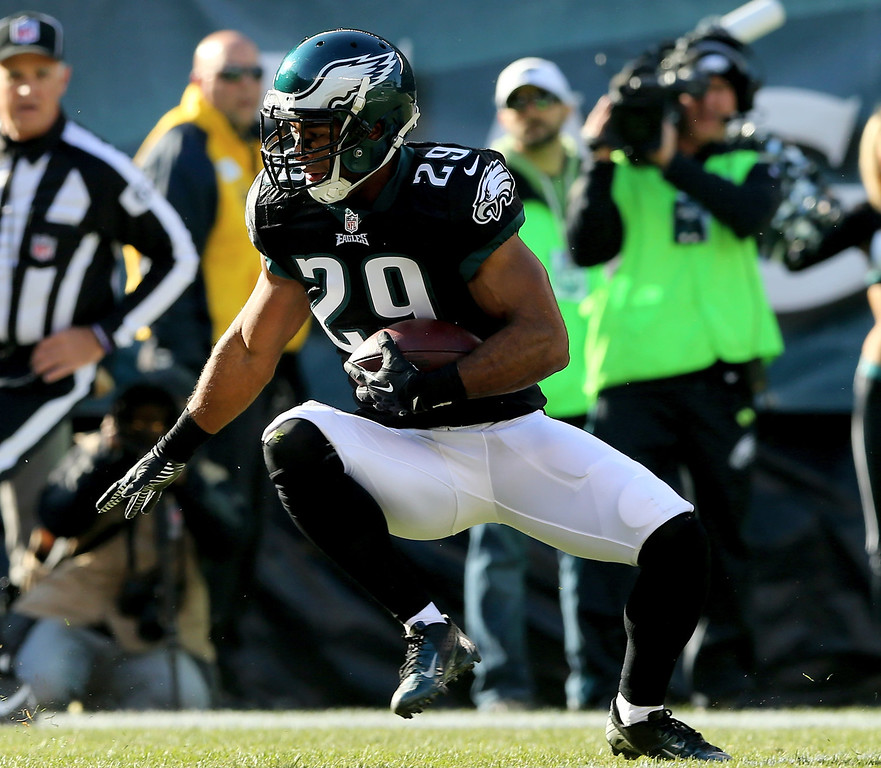 . Nate Allen #29 of the Philadelphia Eagles carries the ball after he intercepted a pass from Carson Palmer of the Arizona Cardinals in the first quarter on December 1, 2013 at Lincoln Financial Field in Philadelphia, Pennslyvania.  (Photo by Elsa/Getty Images)