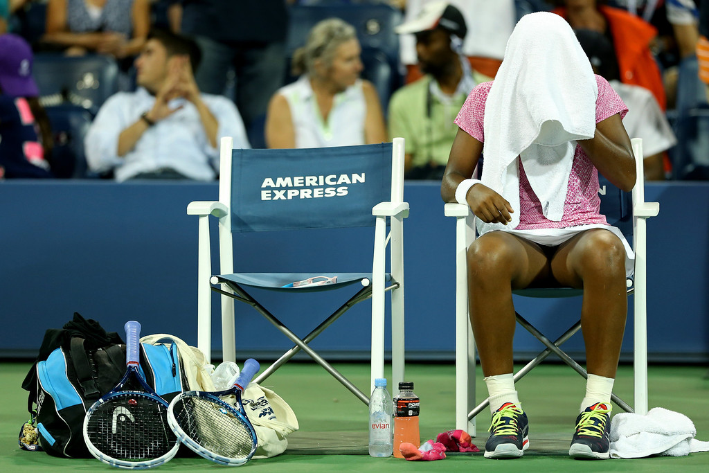 . NEW YORK, NY - AUGUST 29:  Victoria Duval of the United States of America places a towel over her head during a break in her women\'s singles second round match against Daniela Hantuchova of Slovakia on Day Four of the 2013 US Open at USTA Billie Jean King National Tennis Center on August 29, 2013 in the Flushing neighborhood of the Queens borough of New York City.  (Photo by Matthew Stockman/Getty Images)