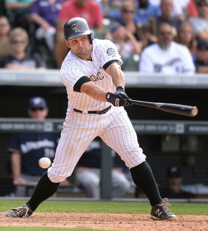 . DENVER, CO - JUNE 20: Colorado batter Michael McKenry stuck out in the eighth inning with runners on base. The Milwaukee Brewers defeated the Colorado Rockies 9-4 at Coors Field Saturday afternoon, June 21, 2014. Photo by Karl Gehring/The Denver Post