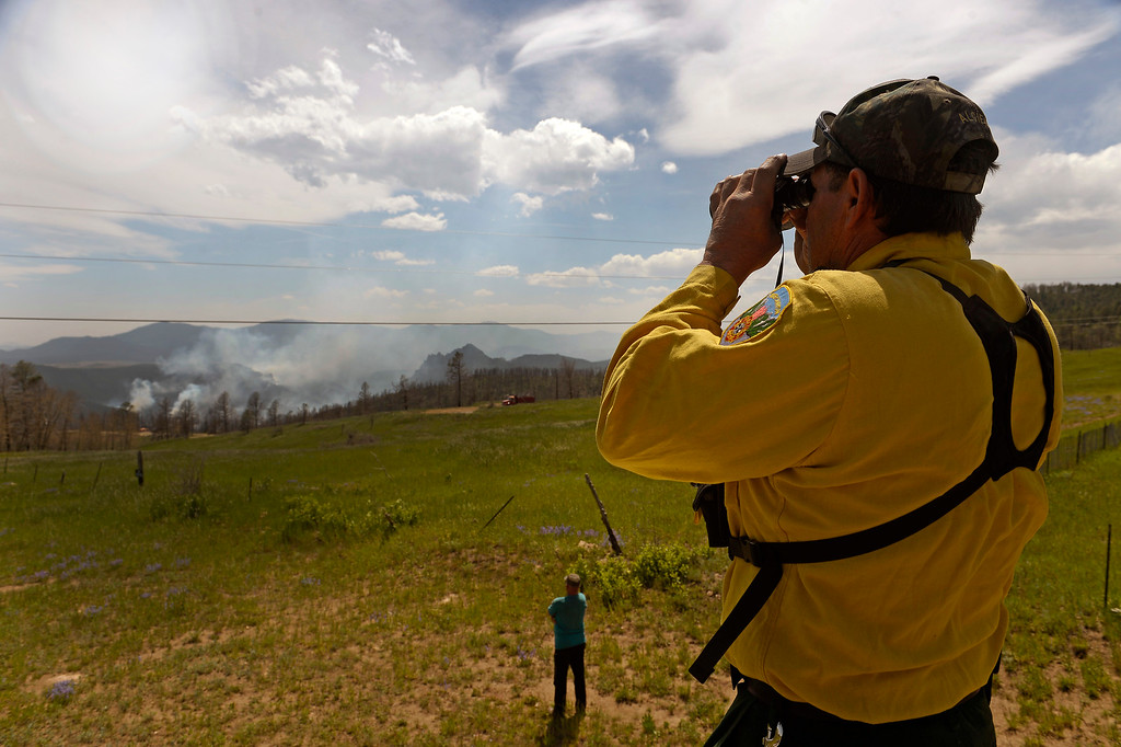 . JEFFERSON COUNTY, CO - JUNE 20:  Gary Algien, a firefighter with inter-Canyon Fire watches the Lime Gulch Fire from Kuehster Road in Jefferson County, CO on June 20,2013.  The Lime Gulch Fire which is burning off of Foxton Road near Conifer, CO continues to burn almost next to last year\'s Lower North Fork fire on June 20, 2013.  Kuehster Road is where many homes burned in the Lower North Fork Fire in March of 2012.  Photo by Helen H. Richardson/The Denver Post)