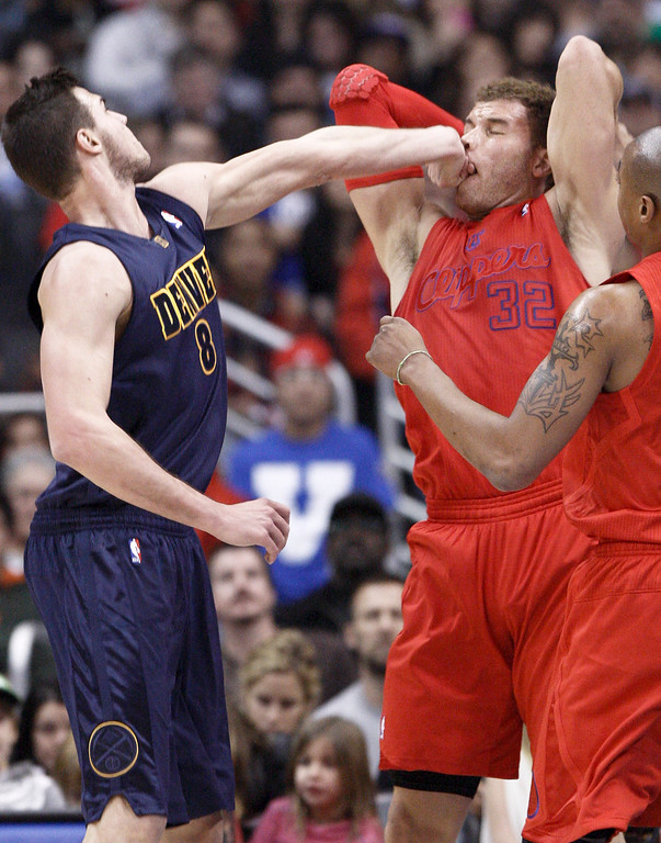 . Los Angeles Clippers forward Blake Griffin (32) is fouled by Denver Nuggets\' Danilo Gallinari (8) of Italy during the first half of their NBA basketball game, Tuesday, Dec. 25, 2012, in Los Angeles. (AP Photo/Jason Redmond)