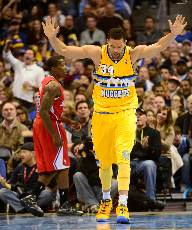 . Denver Nuggets center JaVale McGee (34) celebrates a dunk against the Los Angeles Clippers during the second half of the Nugget\'s 89-74 win at the Pepsi Center on Tuesday, January 1, 2013. AAron Ontiveroz, The Denver Post