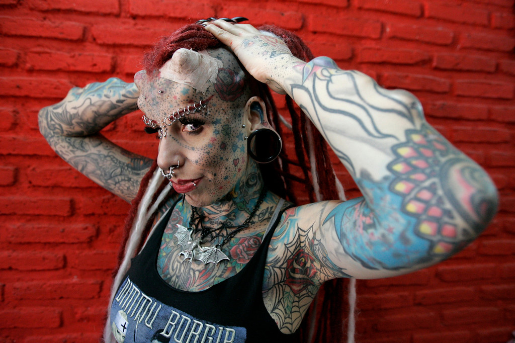 ". Maria Jose Cristerna, a mother of four, tattoo artist and former lawyer, poses for a photograph in Guadalajara March 8, 2012. Cristerna, who is dubbed ""Vampire Woman\"" but prefers to be identified as \""Jaguar Woman\"", had her first tattoo when she was 14 and decided to physically transform herself after having gone through 10 years of domestic violence in her first marriage.     REUTERS/Alejandro Acosta"