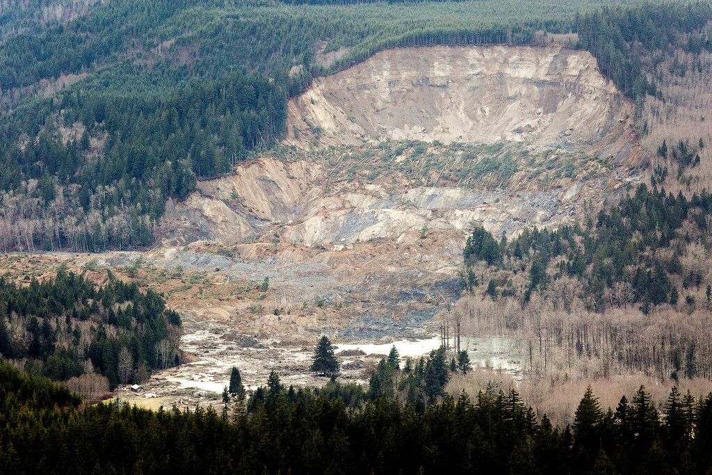 . In this aerial photo taken Saturday, March 23, 2014, a massive mudslide is shown in between the towns of Darrington, Wash., and Arlington, Wash. (The Seattle Times, Marcus Yam)