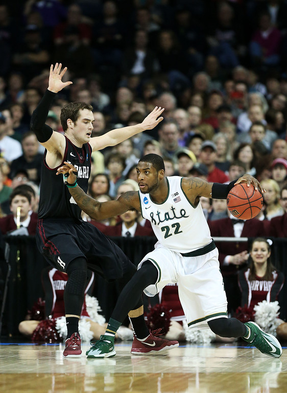 . SPOKANE, WA - MARCH 22:  Branden Dawson #22 of the Michigan State Spartans drives against Laurent Rivard #0 of the Harvard Crimson in the second half during the Third Round of the 2014 NCAA Basketball Tournament at Spokane Veterans Memorial Arena on March 22, 2014 in Spokane, Washington.  (Photo by Stephen Dunn/Getty Images)