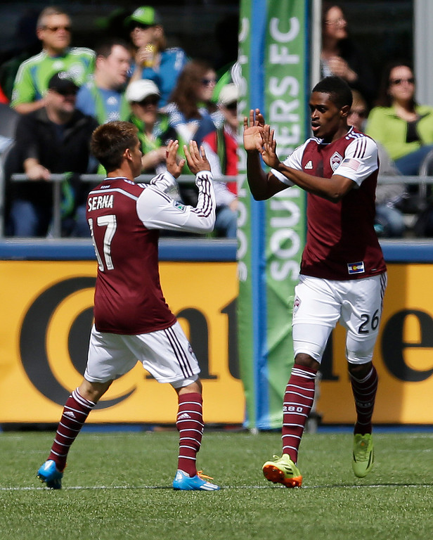. Colorado Rapids\' Dillon Serna, let, greets Deshorn Brown, right, after Serna scored a goal, Saturday, April 26, 2014, in the second half of an MLS soccer match in Seattle. The Sounders defeated the Rapids, 4-1. (AP Photo/Ted S. Warren)