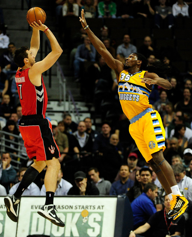 . Denver Nuggets small forward Kenneth Faried (35) defends Toronto Raptors center Andrea Bargnani (7) during the first half at the Pepsi Center on Monday, December 3,sd 2012. AAron Ontiveroz, The Denver Post