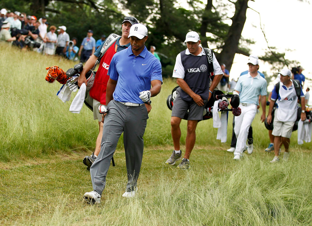 . Tiger Woods of the U.S. walks off the fifth tee during the first round of the 2013 U.S. Open golf championship at the Merion Golf Club in Ardmore, Pennsylvania, June 13, 2013. REUTERS/Adam Hunger