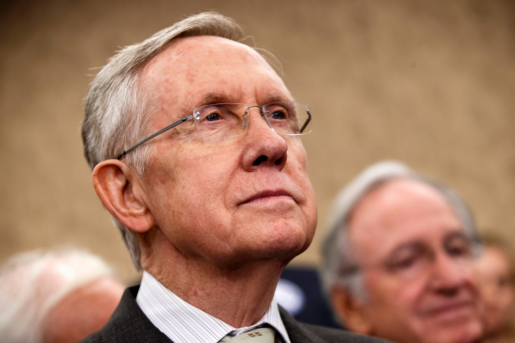 . Senate Majority Leader Harry Reid of Nev., left, and Sen. Tom Harkin, D-Iowa listens to remarks by House Minority Leader Nancy Pelosi of Calif., as they celebrate the start of the Affordable Care Act, popularly known as Obamacare, Tuesday, Oct. 1, 2013, during an event with other lawmakers and people whose lives have been impacted by lack of health insurance, on Capitol Hill in Washington.  (AP Photo/J. Scott Applewhite)