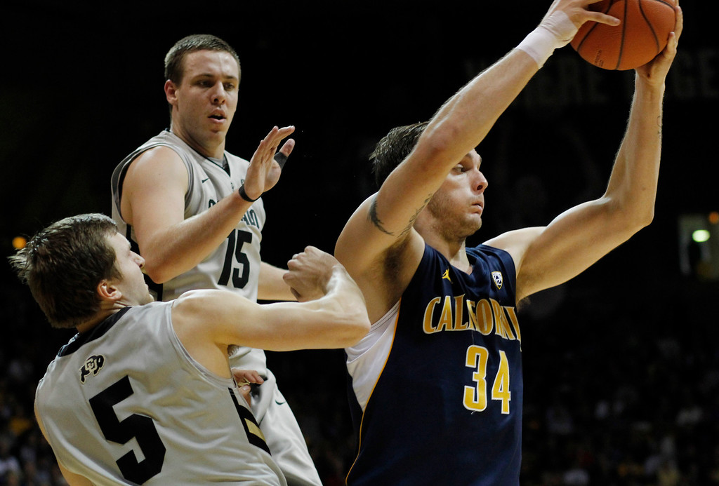 . California forward Robert Thurman, right, pulls down a rebound in front of Colorado guard Eli Stalzer, front left, and forward Shane Harris-Tunks in the first half of an NCAA basketball game in Boulder, Colo., Sunday, Jan. 27, 2013. (AP Photo/David Zalubowski)