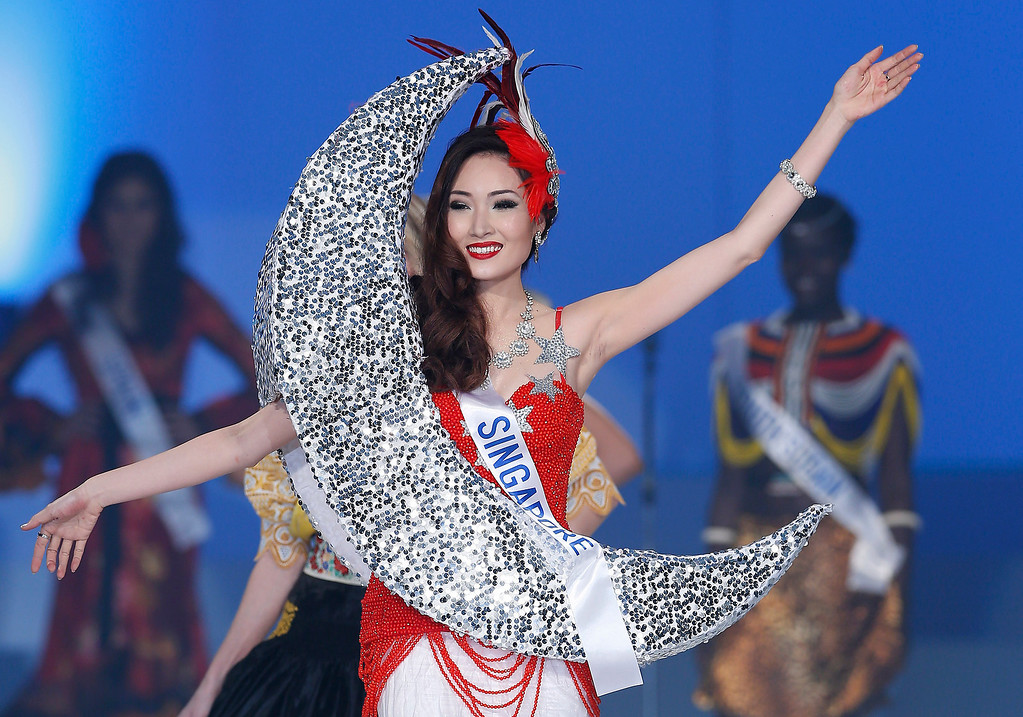 . Miss Singapore Chew Jia Min smiles in the national dress competition during the final of the 53rd Miss International Beauty Pageant in Tokyo Tuesday, Dec. 17, 2013. (AP Photo/Shizuo Kambayashi)