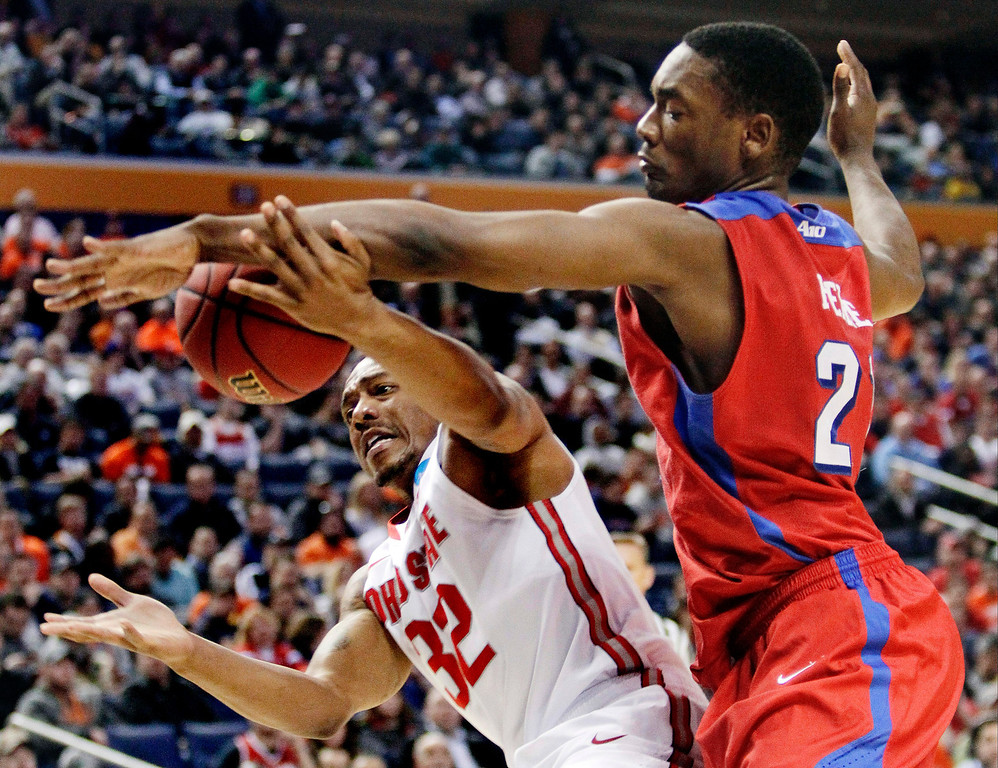 . Dayton\'s Dyshawn Pierre (21) knocks the ball away from Ohio State\'s Lenzelle Smith Jr. (32) during the first half of a second-round game in the NCAA college basketball tournament in Buffalo, N.Y., Thursday, March 20, 2014. (AP Photo/Bill Wippert)