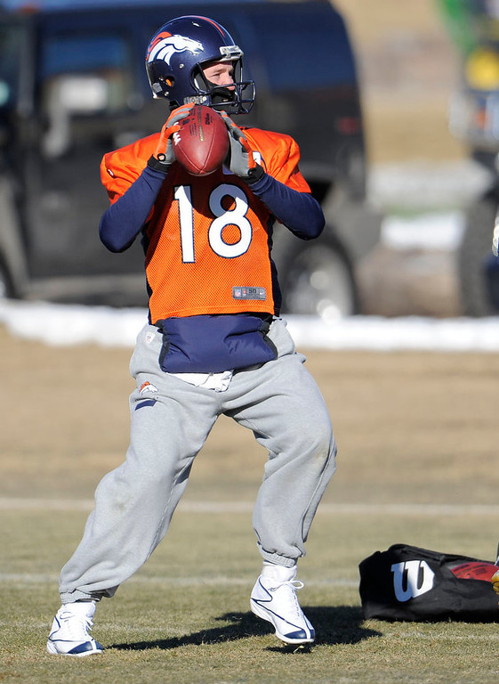 . Denver Broncos quarterback Peyton Manning (18) drops back to pass during practice Thursday, January 3, 2013 at Dove Valley.  John Leyba, The Denver Post