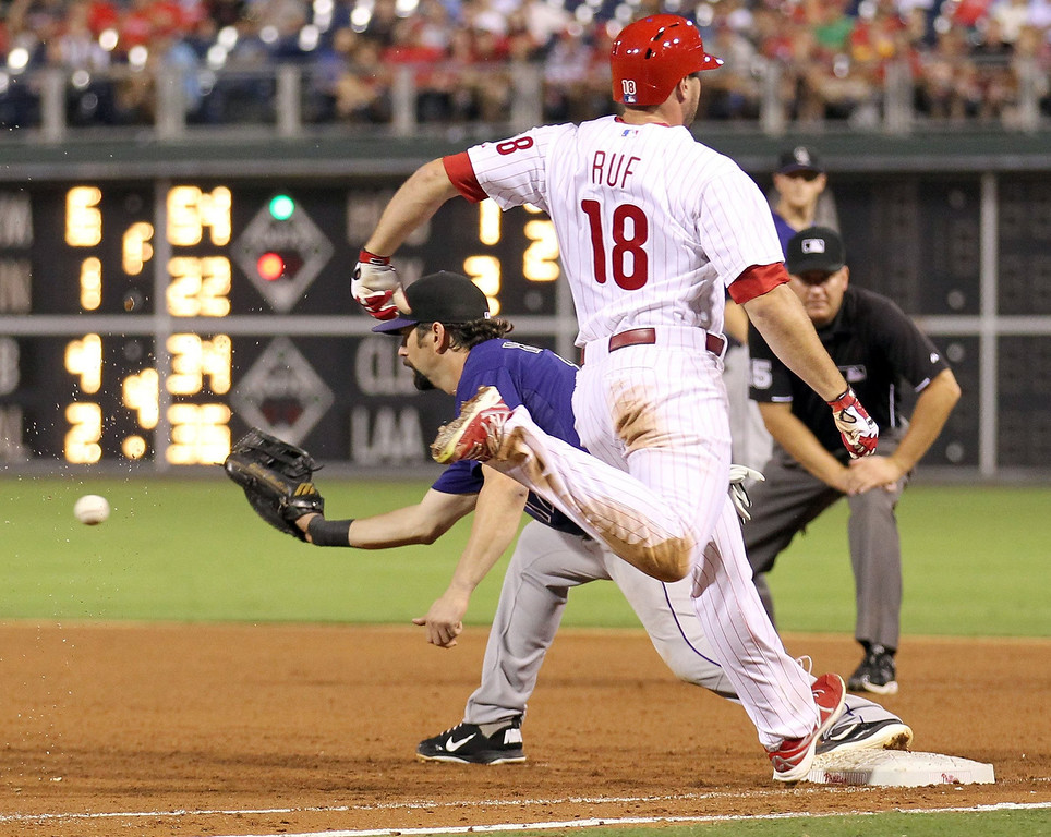 . Philadelphia Phillies\' Darin Ruf reaches first base against Colorado Rockies\' Todd Helton in the sixth inning at Citizens Bank Park in Philadelphia, Pennsylvania, Monday, August 19, 2013. (Yong Kim/Philadelphia Daily News/MCT)