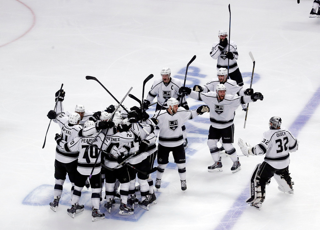 . Los Angeles Kings celebrate after defeating Chicago Blackhawks 5-2 in the overtime period in Game 7 of the Western Conference finals in the NHL hockey Stanley Cup playoffs Sunday, June 1, 2014, in Chicago. (AP Photo/Charles Rex Arbogast)