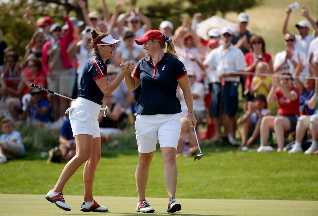 . PARKER, CO. - August 16: Brittany Lang, left, and Brittany Lincicome of team USA celebrate Lincicome\'s birdie putt on 9th green during 2013 Solheim Cup at Colorado Golf Club. Parker, Colorado. August 16, 2013. (Photo By Hyoung Chang/The Denver Post)