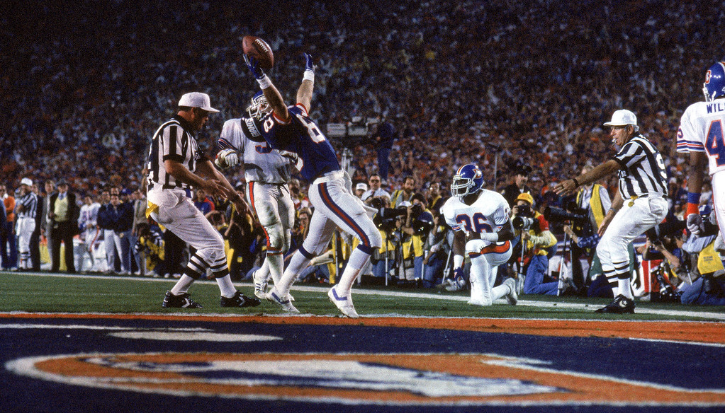 . Wide receiver Phil McConkey #80 of the New York Giants reacts after being stopped short of the goal line against the Denver Broncos during Super Bowl XXI at the Rose Bowl on January 25, 1987 in Pasadena, California. (Photo by George Rose/Getty Images)
