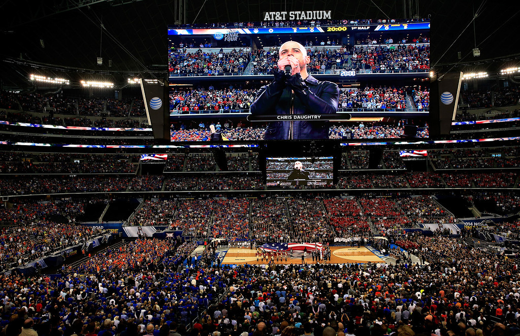 . ARLINGTON, TX - APRIL 05: Chris Daughtry performs the national anthem prior to the NCAA Men\'s Final Four Semifinal between the Connecticut Huskies and the Florida Gators at AT&T Stadium on April 5, 2014 in Arlington, Texas.  (Photo by Jamie Squire/Getty Images)