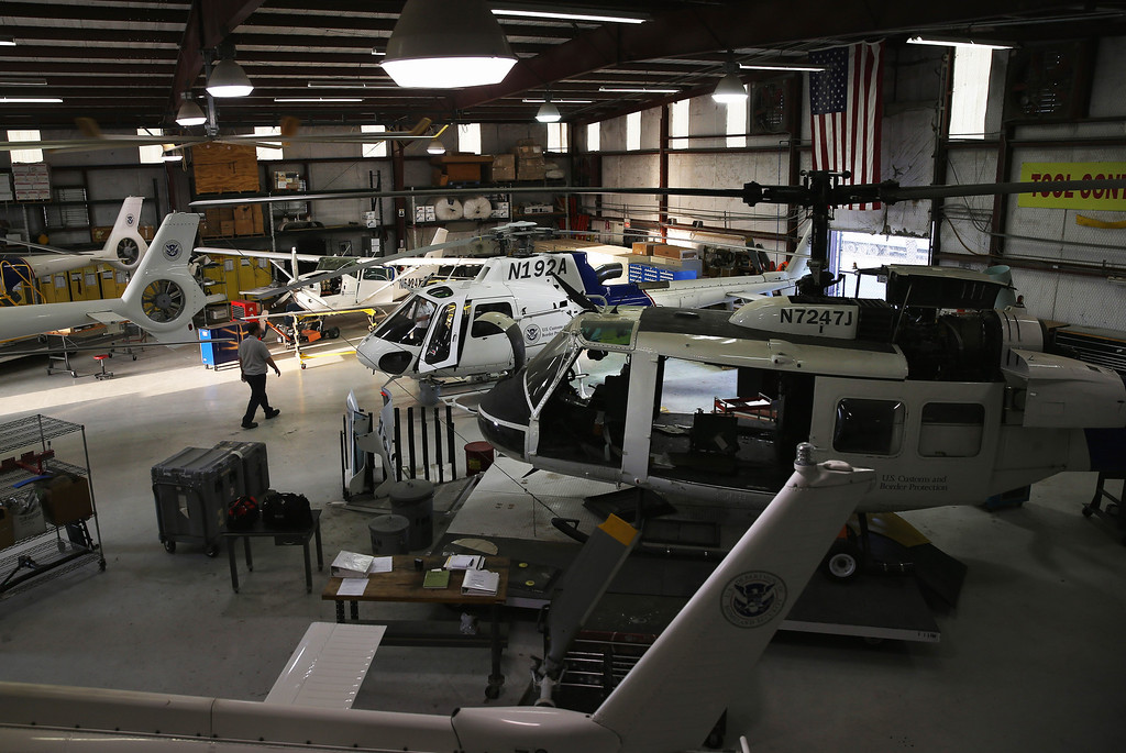 . MCALLEN TX - APRIL 11:  U.S. Office of Air and Marine (OAM) helicopters sit in a hangar along the U.S.-Mexico border on April 11, 2013 in McAllen, Texas. The OAM, which assists U.S. Border Patrol agents from the air in locating undocumented immigrants and drug smugglers, has cut back flights drastically due to federal sequestration budget cuts. According to the U.S. Border Patrol, undocumented immigrant crossings have increased more than 50 percent in the Rio Grande Valley sector in the last year. Border Patrol agents say they have also seen an additional surge in immigrant traffic since immigration reform negotiations began this year in Washington D.C. Proposed refoms could provide a path to citizenship for many of the estimated 11 million undocumented workers living in the United States.  (Photo by John Moore/Getty Images)