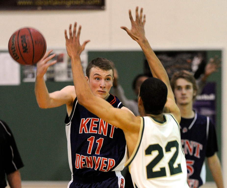 . Sun Devils senior guard Matt Pettyjohn (11) heaved the ball downcourt in the final second of the game. The Kent Denver High School boy\'s basketball team defeated Bishop Machebeuf 77-75 Tuesday night, January 15, 2013. Karl Gehring/The Denver Post
