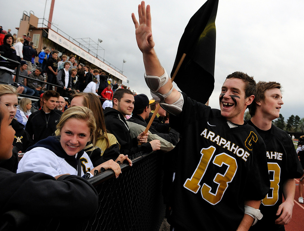 . DENVER, CO - MAY 15: Arapahoe High School senior midfielder Kiely O\'Connor #13 waves to the crowd after his team defeated Regis Jesuit during a semifinals CHSAA 5A boys lacrosse game at All City Stadium on May 15, 2013, in Denver, Colorado. Arapahoe won 13-5 to advance to the finals. (Photo by Daniel Petty/The Denver Post)