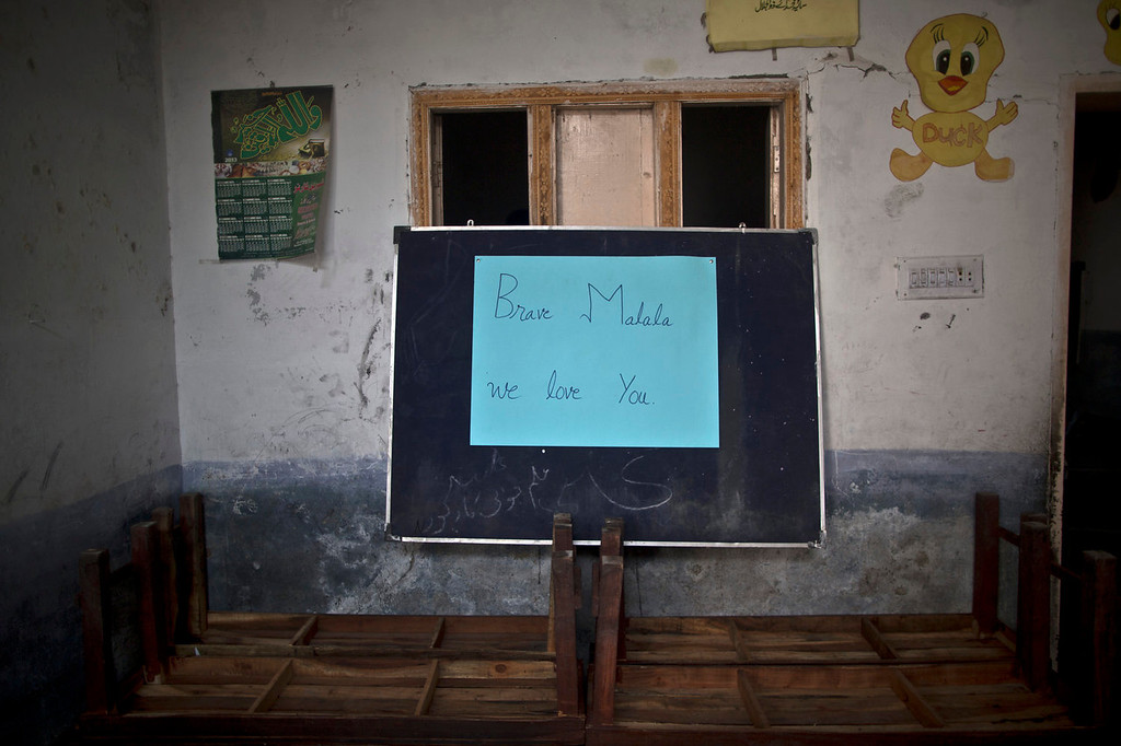 . A placard to commemorate the anniversary of Malala Yousufzai\'s shooting by the Taliban, is placed on a blackboard at a school in Rawalpindi, Pakistan, Wednesday, Oct. 9, 2013. One year after a Taliban bullet tried to silence Malala\'s demand for education, she has published a book and is a contender for the Nobel Peace Prize. But the militants threaten to kill her should she dare return home from Britain to Pakistan, and the principal at her old school says that as Malala\'s fame has grown, so has fear in her classrooms. (AP Photo/Muhammed Muheisen)