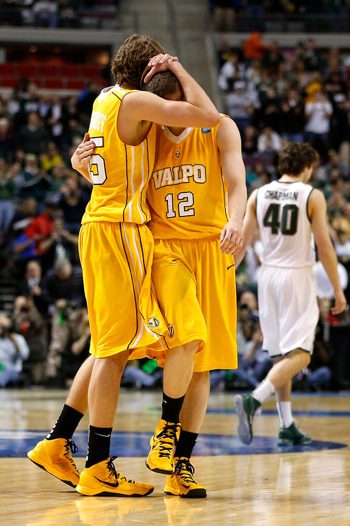 . (L-R) Ryan Broekhoff #45 and Ben Boggs #12 of the Valparaiso Crusaders react dejected after they lost 65-54 against the Michigan State Spartans during the second round of the 2013 NCAA Men\'s Basketball Tournament at at The Palace of Auburn Hills on March 21, 2013 in Auburn Hills, Michigan.  (Photo by Gregory Shamus/Getty Images)