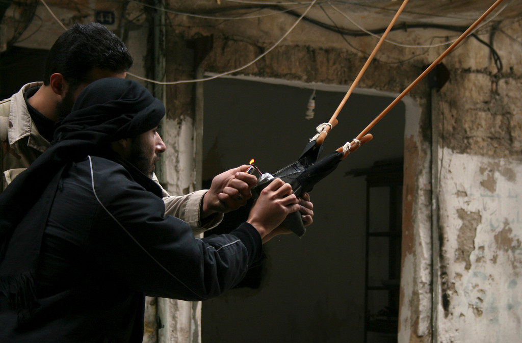 . Free Syrian Army fighters use a catapult to launch a handmade grenade during clashes with forces loyal to Syria\'s President Bashar al-Assad, in the Aleppo district of Salaheddine February 12, 2013. Picture taken February 12, 2013. REUTERS/Aref Hretani