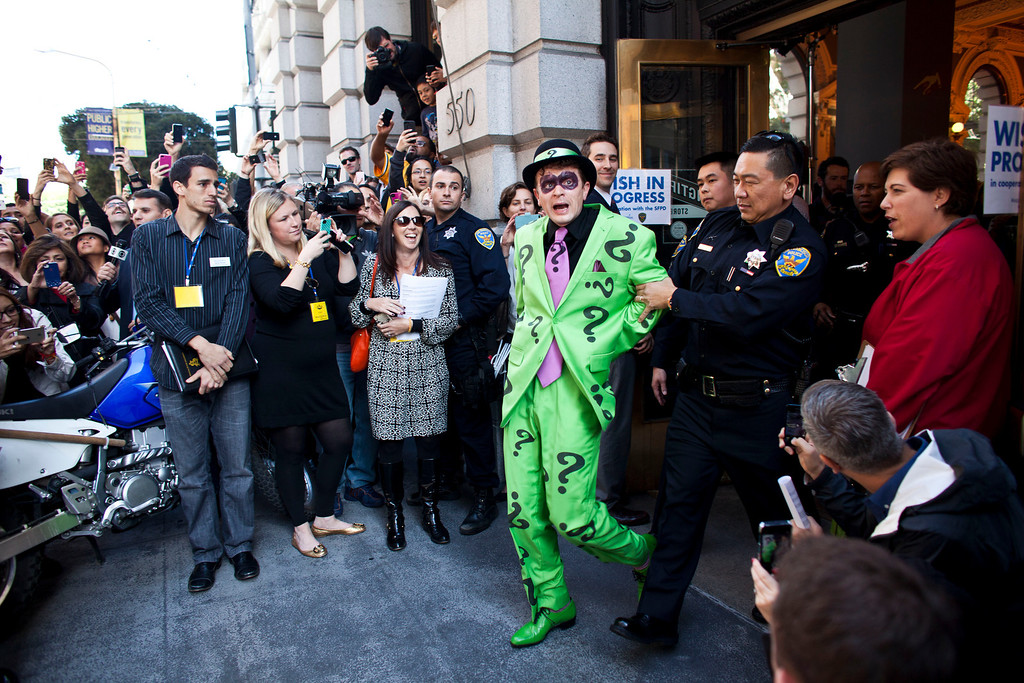 . San Francisco police officers arrest the Riddler with the help of 5-year-old leukemia survivor Miles, also known as BatKid November 15, 2013 in San Francisco. Make-A-Wish Greater Bay Area foundation turned the city into Gotham City for Miles by creating a day long event bringing his wish to be a BatKid to life. (Photo by Ramin Talaie/Getty Images)