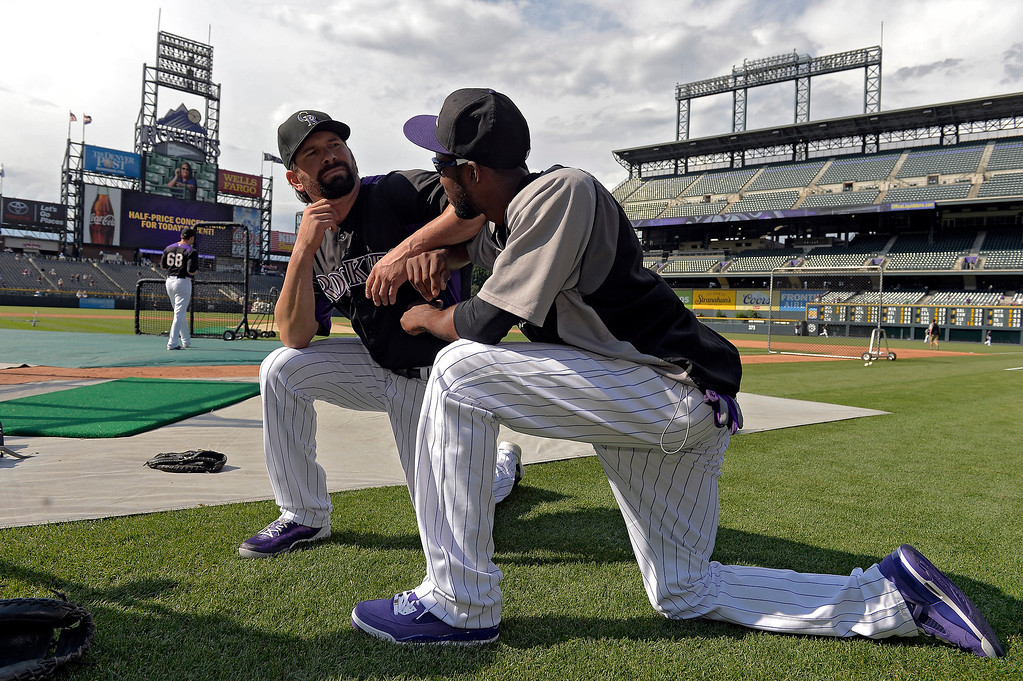 . Colorado Rockies Todd Helton poses with Dexter Fowler during an open workout session for the fans July 18, 2013 at Coors Field. (Photo By John Leyba/The Denver Post)