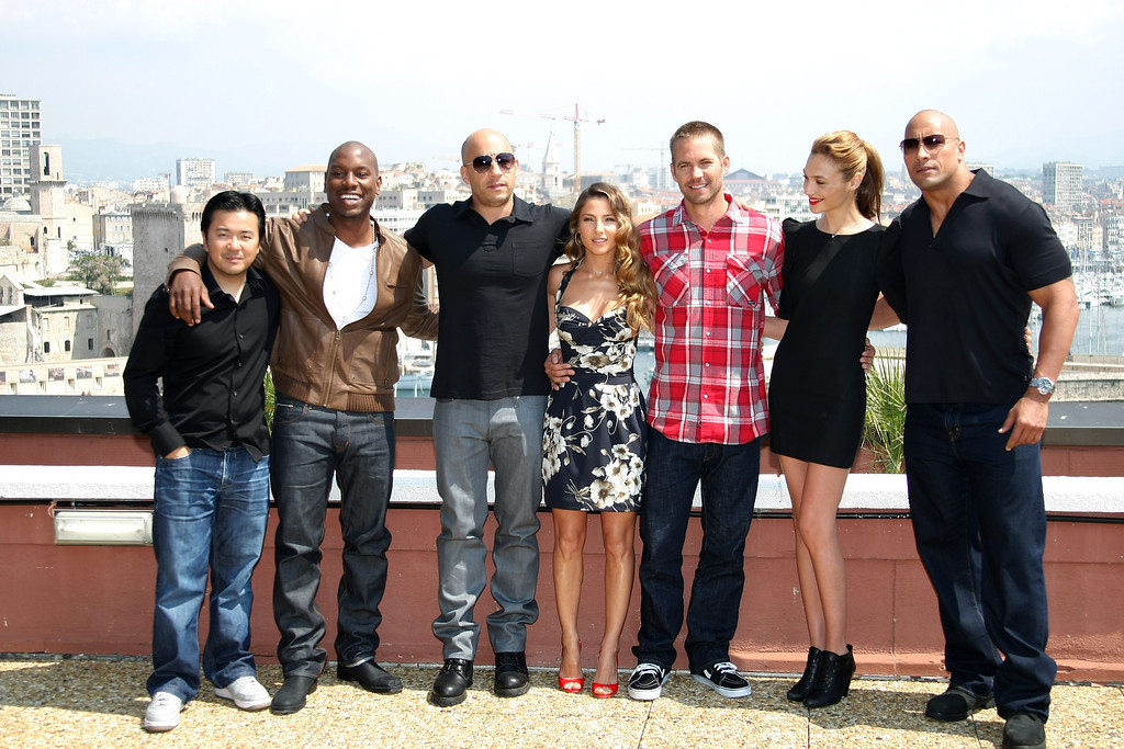 """. Taiwanese director Justin Lin, left, stands with actors Tyrese Gibson, Vin Diesel, Elsa Pataky, Paul Walker, Gal Gadot and Dwayne Johnson, from left, during a photocall to promote the film \""""Fast and Furious 5: Rio Heist\"""", in Marseille, southern France, Thursday, April 28, 2011. (AP Photo/Claude Paris)"""
