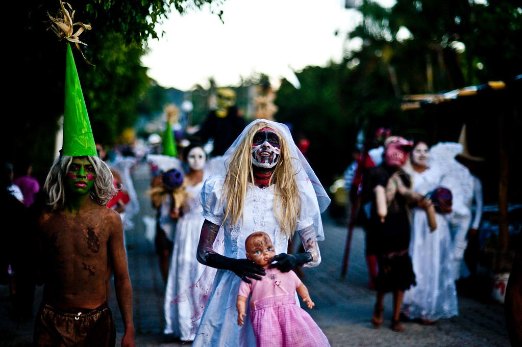 """. Young revellers take part in a parade called \""""La Calabiuza\"""" on November 1, 2013, on the eve of the Day of the Dead in Tonacatepeque, 20 kms (13 miles) north of San Salvador, El Salvador. During the celebration, the residents of Tonacatepeque, originally an indigenous community, recall the characters of the mythology of Cuscatlan --pre-Columbian west and central regions of El Salvador-- and their dead relatives. Jose CABEZAS/AFP/Getty Images"""