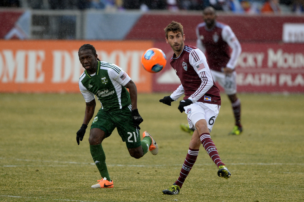 . COMMERCE CITY MARCH 22: Jose Mari of Colorado Rapids (6), right, clears the ball against Diego Chara of Portland Timbers (21) in the 1st half of the game at Dick\'s Sporting Goods Park. Commerce City, Colorado. March 22. 2014. Colorado won 2-0. (Photo by Hyoung Chang/The Denver Post)