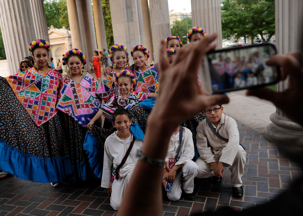 . Members of the Grupo Folklorico Mexico Mixto dance troupe posed for a photograph before they took the stage. Denver celebrated Mexico Night in Civic Center Park Thursday night, July 18, 2013.     Photo By Karl Gehring/The Denver Post